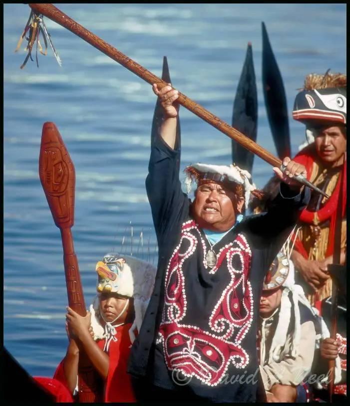 Kwakwak'awakw chief with a talking stick.