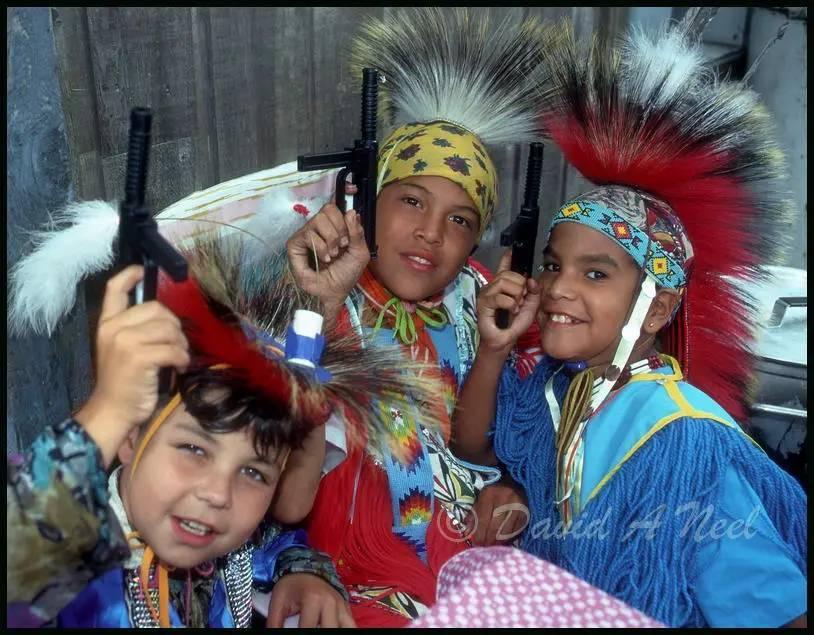 Canadian Indigenous boys taking a break from dancing.