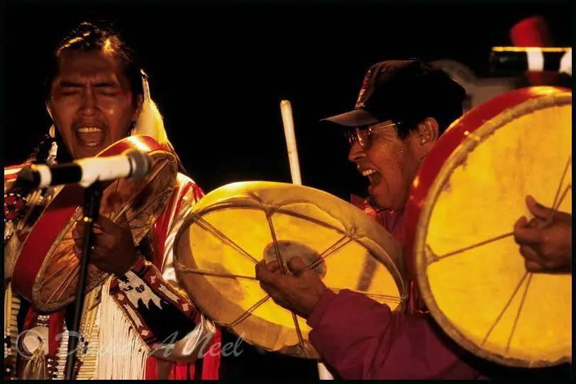 Native American hand drum singers.