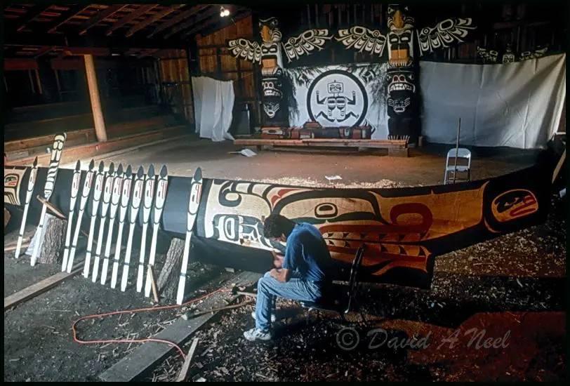 Kwakwak'awakw canoe paddles being carved.