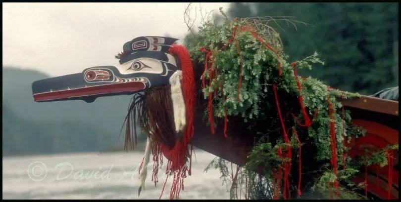 A Hok-hok mask on a Kwakwak'awakw (Kwakiutl) canoe for a ceremonial arrival ceremony.