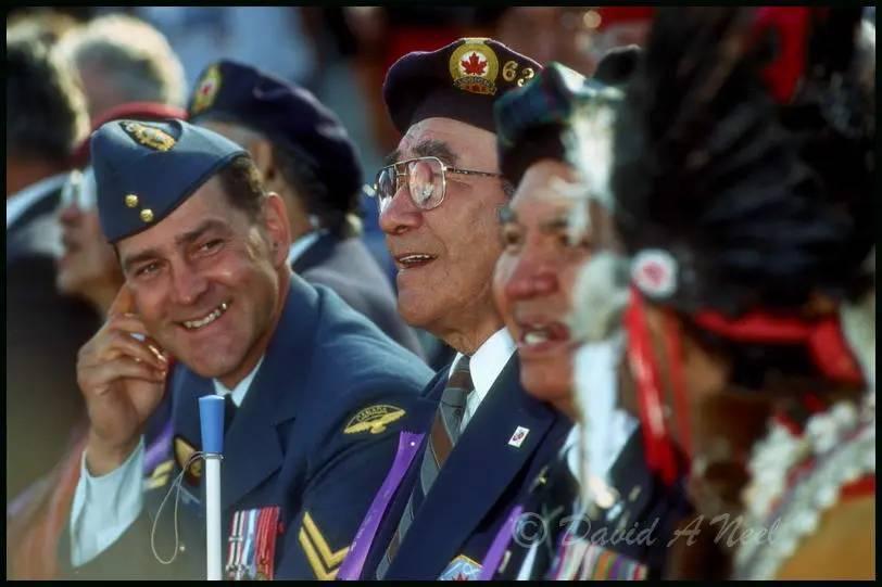 Native American war veterans share a laugh.