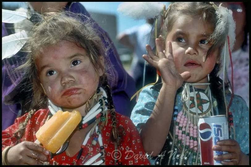 Native girls enjoying a snack at a powwow.