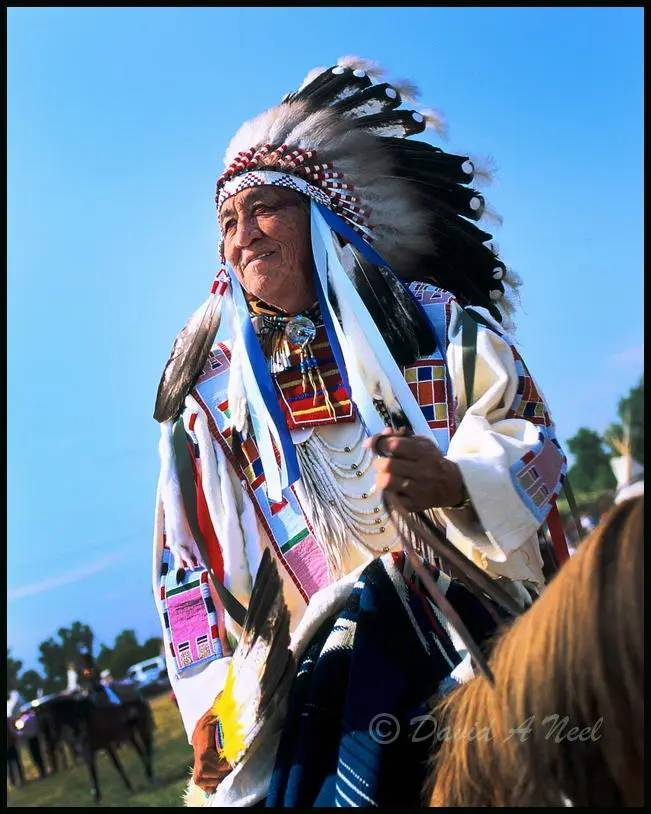 Crow Indian chief on horseback.