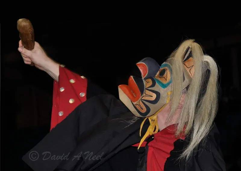 A Kwakwak'awakw mask dancer at a potlatch.